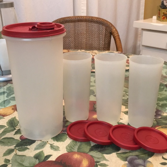 Tupperware round pitcher and 3 cups with lids